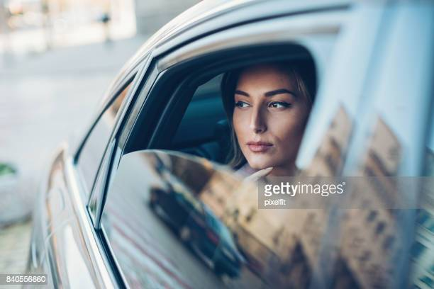 woman in a car - stereotypically upper class stock pictures, royalty-free photos & images