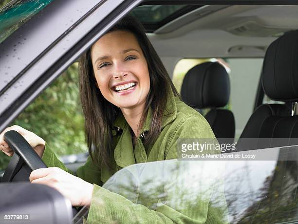 Woman in a car, smiling