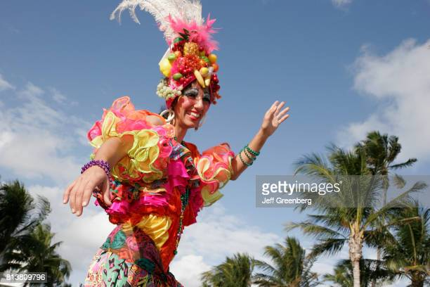 A woman in a Carmen Miranda character costume at the Art Deco Weekend on Ocean Drive