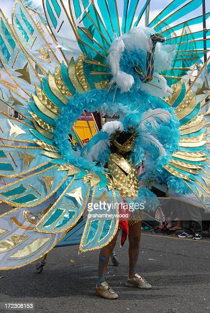 woman in a carnival parade as a blue peacock  - chelsea mask stock pictures, royalty-free photos & images