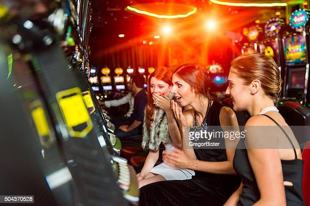 Woman in a casino winning at slot machine