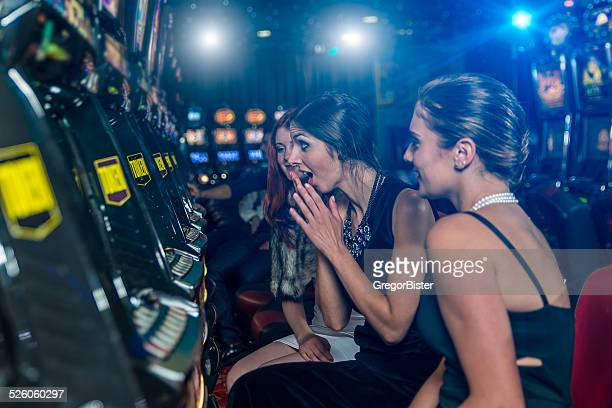 woman in a casino winning at slot machine - teen pokies stock photos and pictures