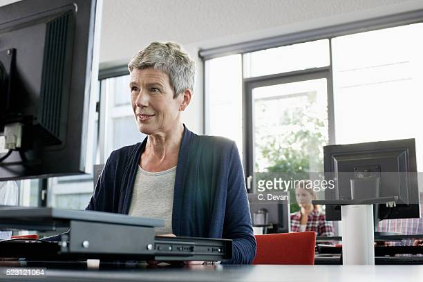 Woman in a class using a computer