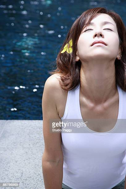 Woman in a cobra pose at the poolside