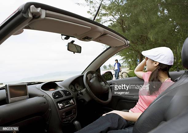 A woman in a convertible