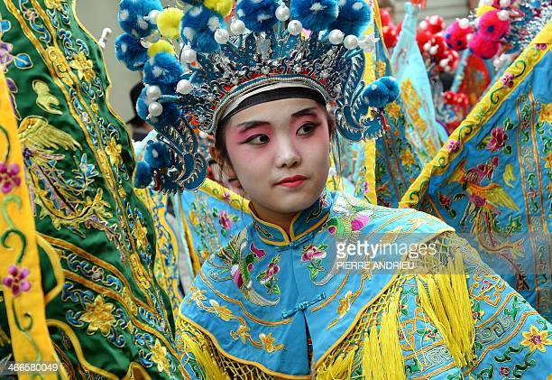 A woman in a costume takes part in a parade to celebrate the Chinese Lunar New Year on February 2 2014 in Paris The lunar calendar is based on the...