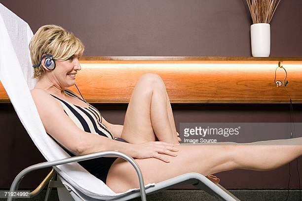 Woman in a deckchair listening to music