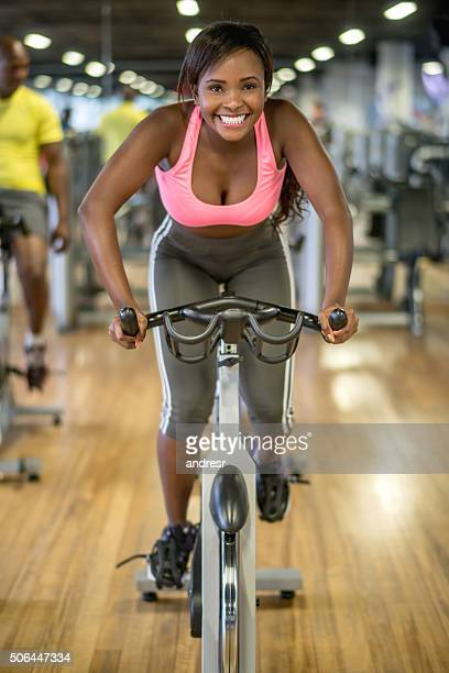 woman in a exercising class at the gym - spinning stock pictures, royalty-free photos & images