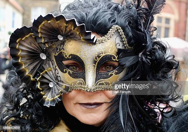 Woman in a face mask poses for the camera during the Goth weekend on April 26, 2014 in Whitby, England. The Whitby Goth weekend began in 1994 and...