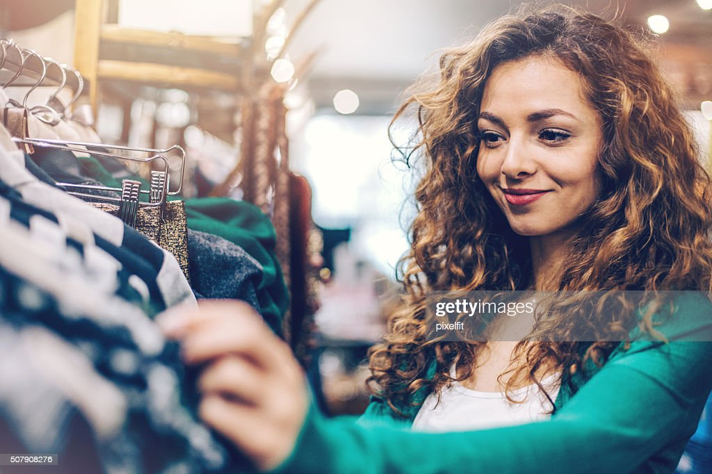 Woman in a fashion store department : Stock Photo
