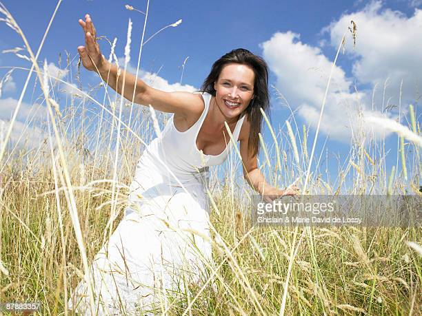 Woman in a field,  looking at camera