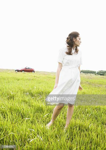 A woman in a field of grass