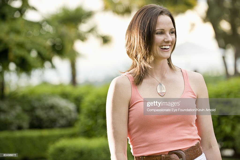 Woman in a garden, smiling. : Stock Photo