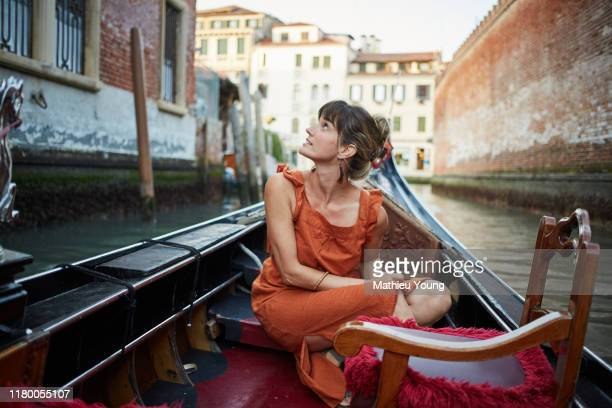 woman in a gondola - vacations stock pictures, royalty-free photos & images