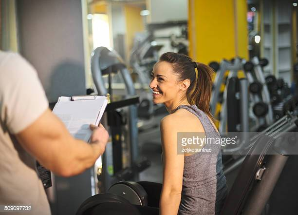 Woman in a gym with personal trainer