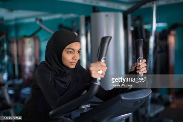 woman in a hijab working out - sarah hardy stock pictures, royalty-free photos & images