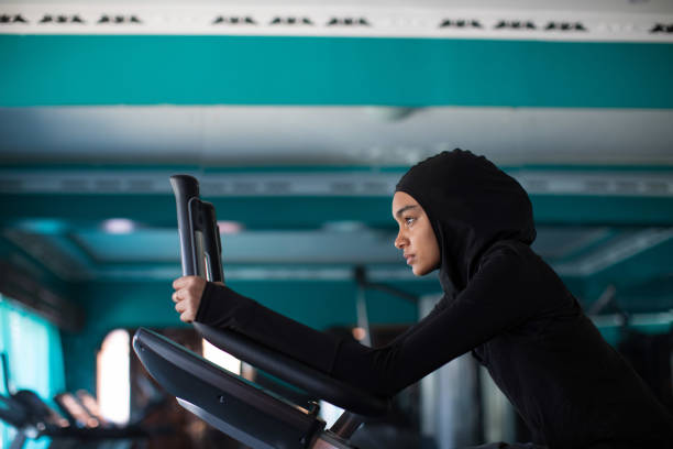 Woman in a hijab working out