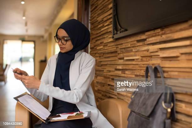 Woman in a hijab working