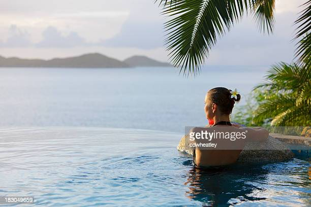 woman in a infinity pool hot tub at the resort spa - caribbean sea stock pictures, royalty-free photos & images