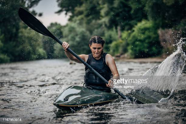 woman in a kayak - rafting stock pictures, royalty-free photos & images