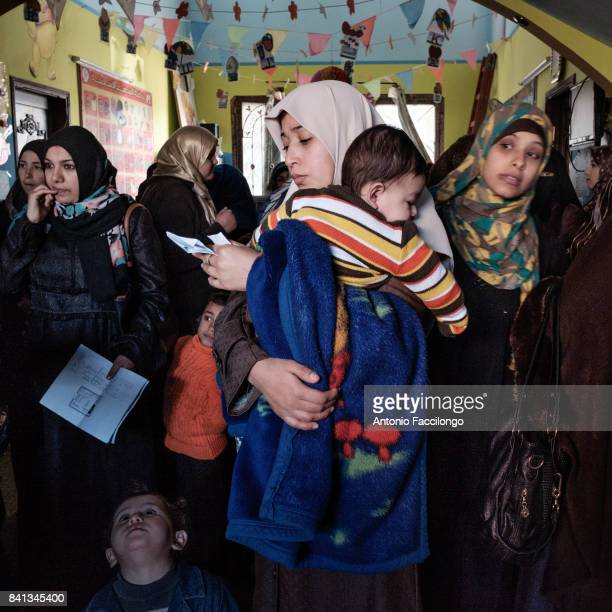 A woman in a kindergarten during the free distribution of school supplies This is the story of Palestinian prisoners'u2019 wives who have turned to...