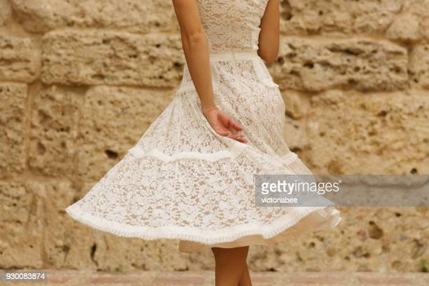 woman in a lace dress spinning around - frilly stock photos and pictures