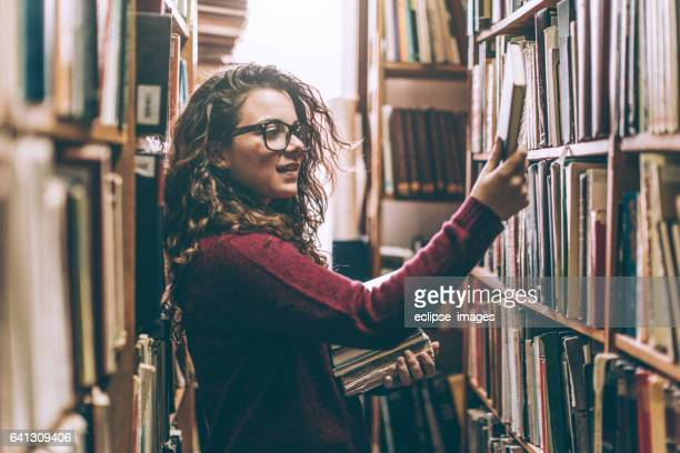 woman in a library - essentials collection stock pictures, royalty-free photos & images