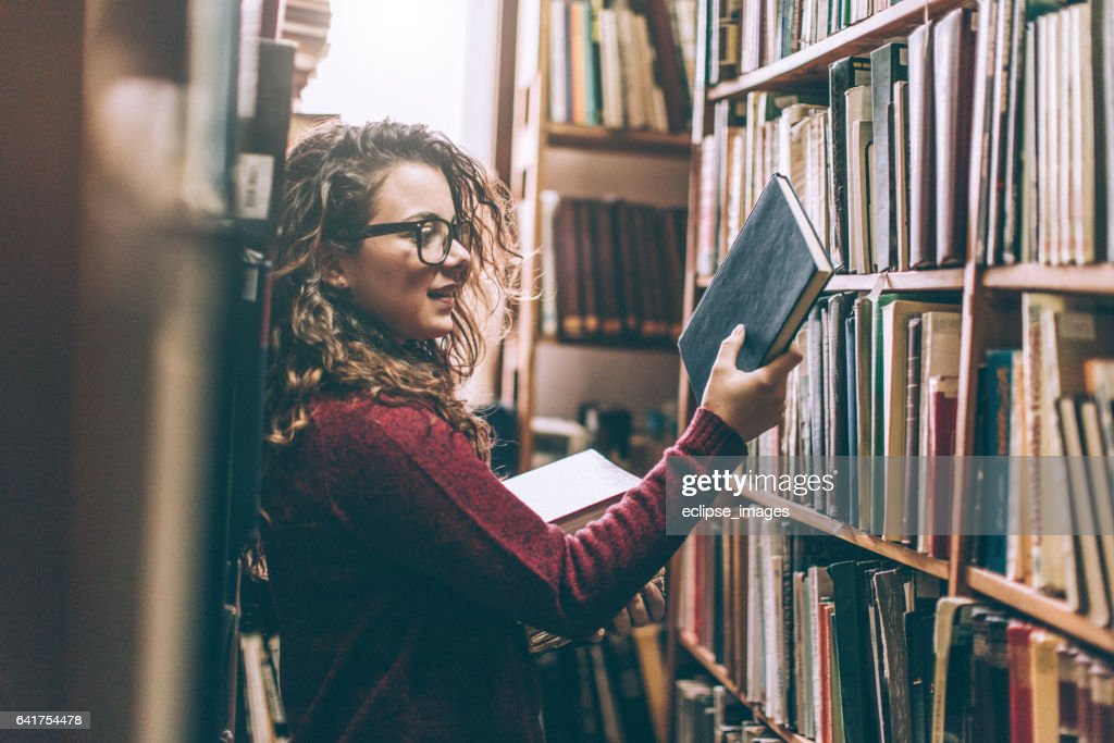 Woman in a Library : Stock Photo