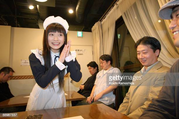 A woman in a maid costume serves customers the Maid Coffee Shop in the Akihabara District October 23 2005 in Tokyo Japan The Akihabara District is...