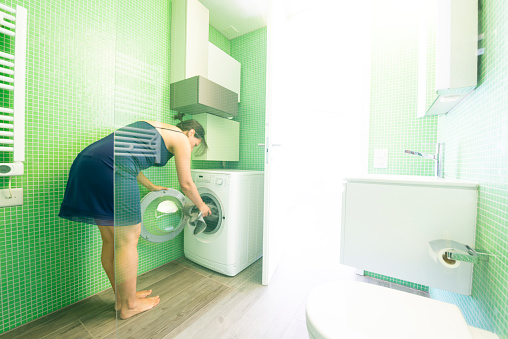 Woman in a Modern Bathroom - gettyimageskorea