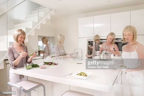 Woman in a modern kitchen preparing a healthy meal