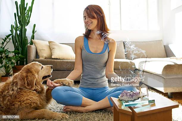 Woman in a moment of spirituality with the dog