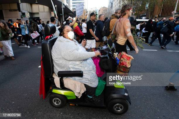 Woman in a motorised wheel chair marches from Sydney Town Hall along Castlereagh St to Belmore Park on 06 June, 2020 in Sydney, Australia. This event...