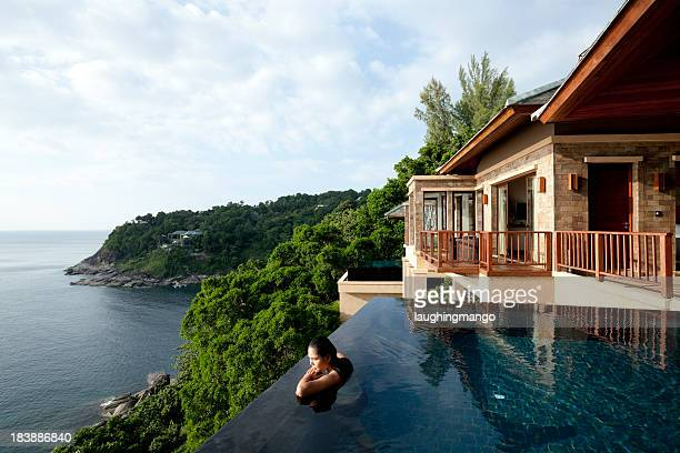 a woman in a oil overlooking phuket, thailand - stereotypically upper class stock pictures, royalty-free photos & images