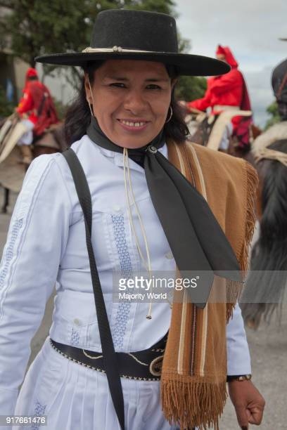 Woman in a parade of gauchos in traditional costume in Salta Argentina