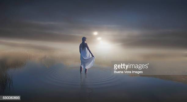 Woman in a pond in the mist