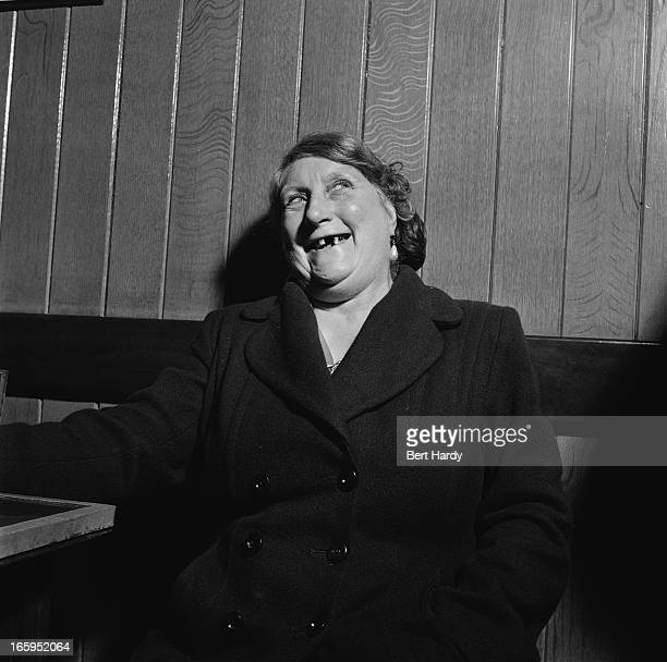 A woman in a pub during a coach trip to Southend Essex 1952 Original publication Picture Post 5570 Southend Beano pub 1952