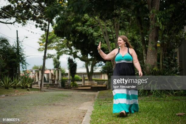 woman in a quiet neighborhood - long dress stock pictures, royalty-free photos & images