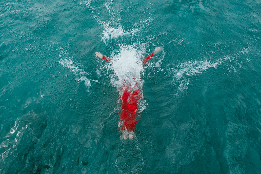 Woman in a red dress in turquoise water - gettyimageskorea