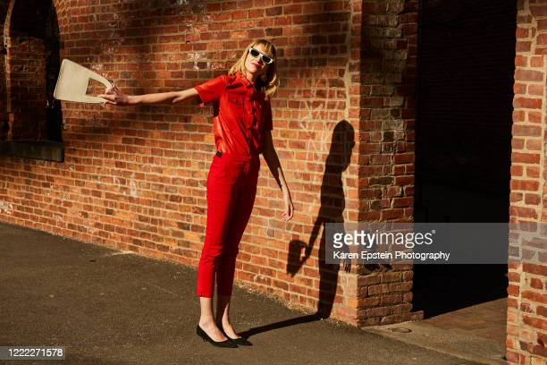 woman in a red suit in dumbo brooklyn - street style ストックフォトと画像