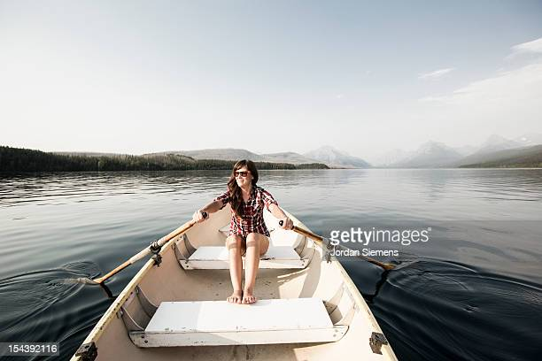 A woman in a row boat.