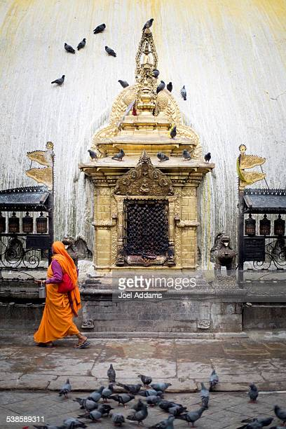 A woman in a sari in front of temple.