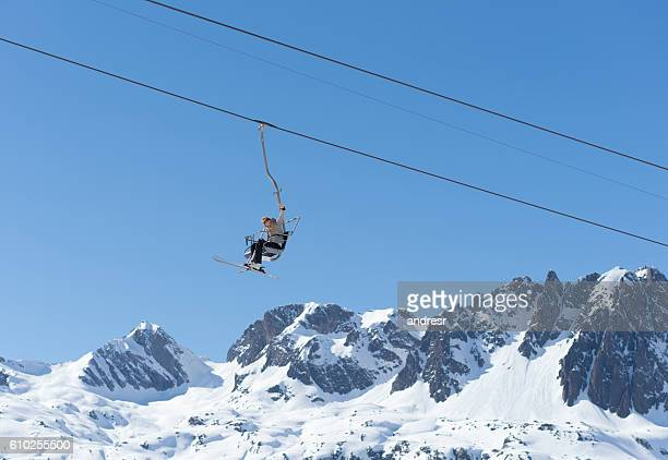 woman in a ski lift chair - ski lift stock pictures, royalty-free photos & images