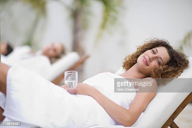 Woman in a spa on deckchair