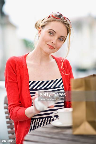 woman in a street cafe glancing at s.o. - sugar coffee stock photos and pictures