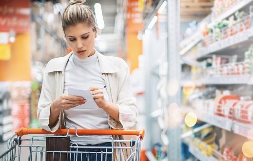 Woman in a supermarket. - gettyimageskorea