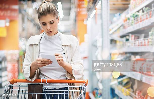 woman in a supermarket. - list stock pictures, royalty-free photos & images