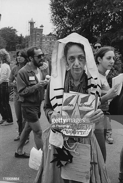 A woman in a tallit publicises the Anne Frank Requiem Committee in Central Park New York City 1982