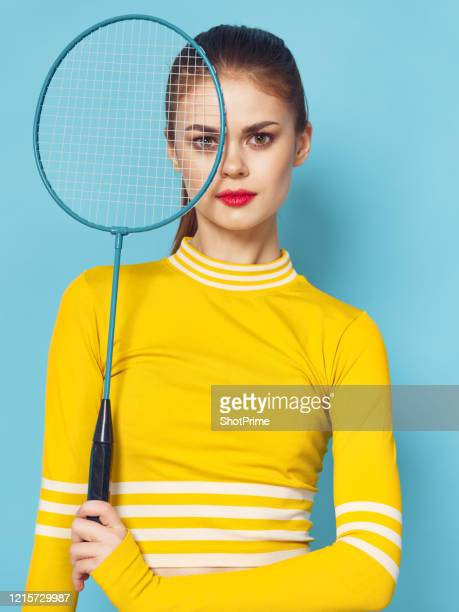 a woman in a tracksuit came to badminton training. - world sports championship stock pictures, royalty-free photos & images