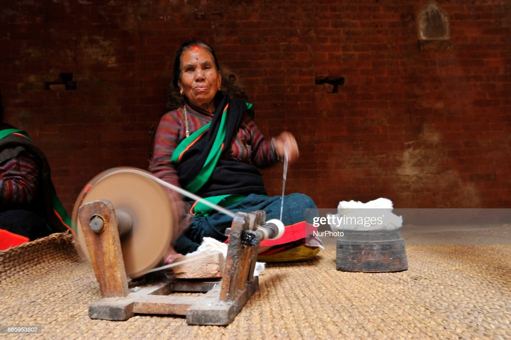 A woman in a traditional attire rolls wool during inauguration ceremony of Jyapu Museum on the occasion of 72nd United Nations Day in Chyasal, Lalitpur, Nepal on Tuesday, October 24, 2017.